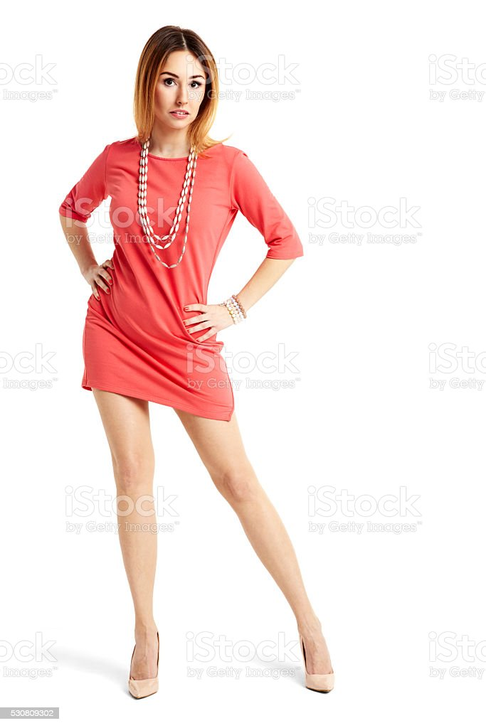 Attractive woman in red dress stock photo