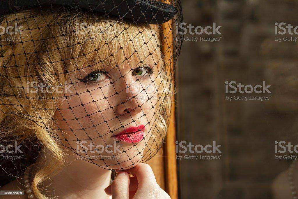 Attractive woman in retro fashion on a train stock photo