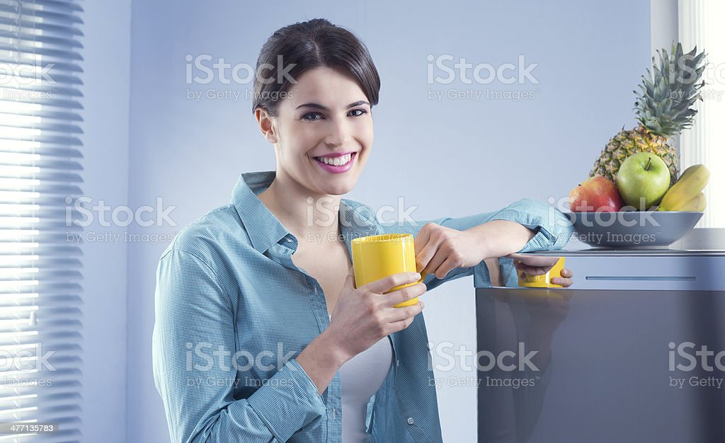 Attractive woman in the kitchen royalty-free stock photo