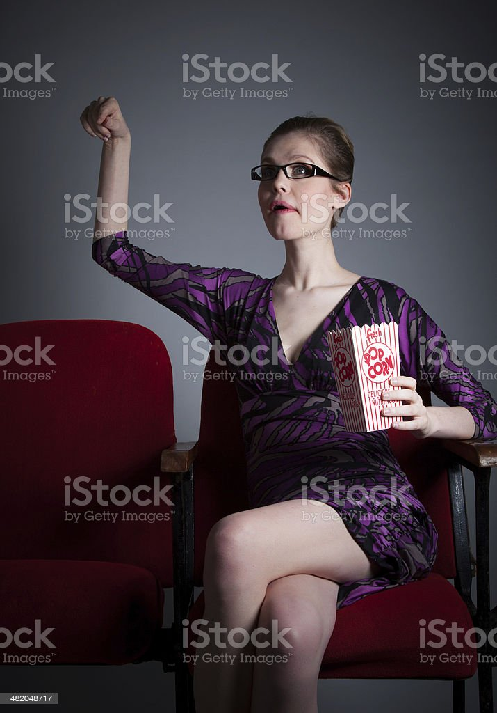 Attractive woman in theatre isolated on grey background royalty-free stock photo