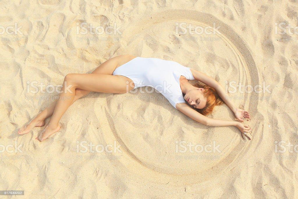 Attractive woman in white swimwear stock photo