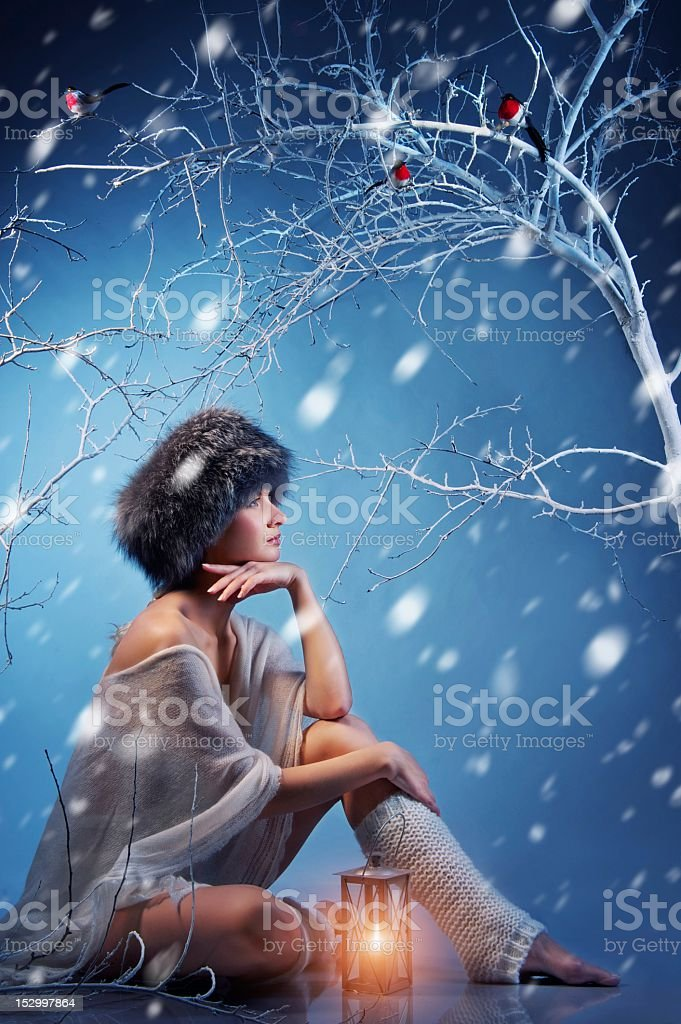 Attractive woman in winter forest royalty-free stock photo