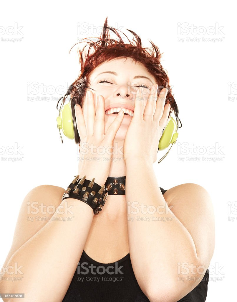 Attractive woman laughing wearing headphones royalty-free stock photo