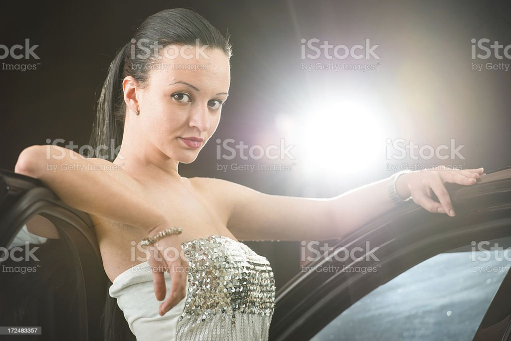 Attractive woman leaning on a car. royalty-free stock photo