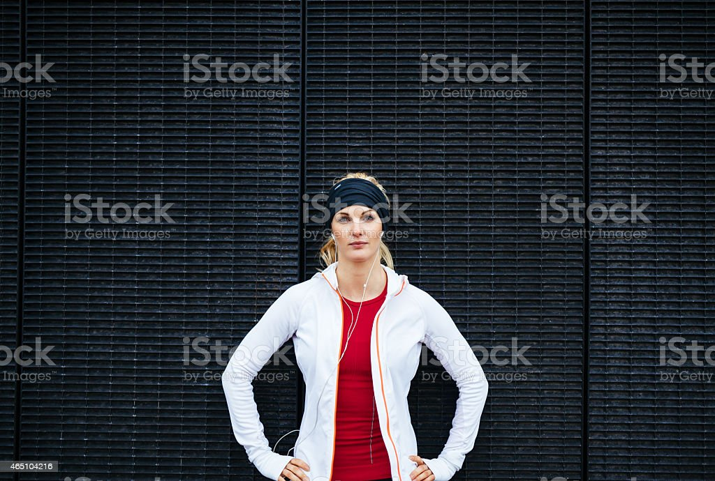 Attractive woman looking confident in sportswear stock photo