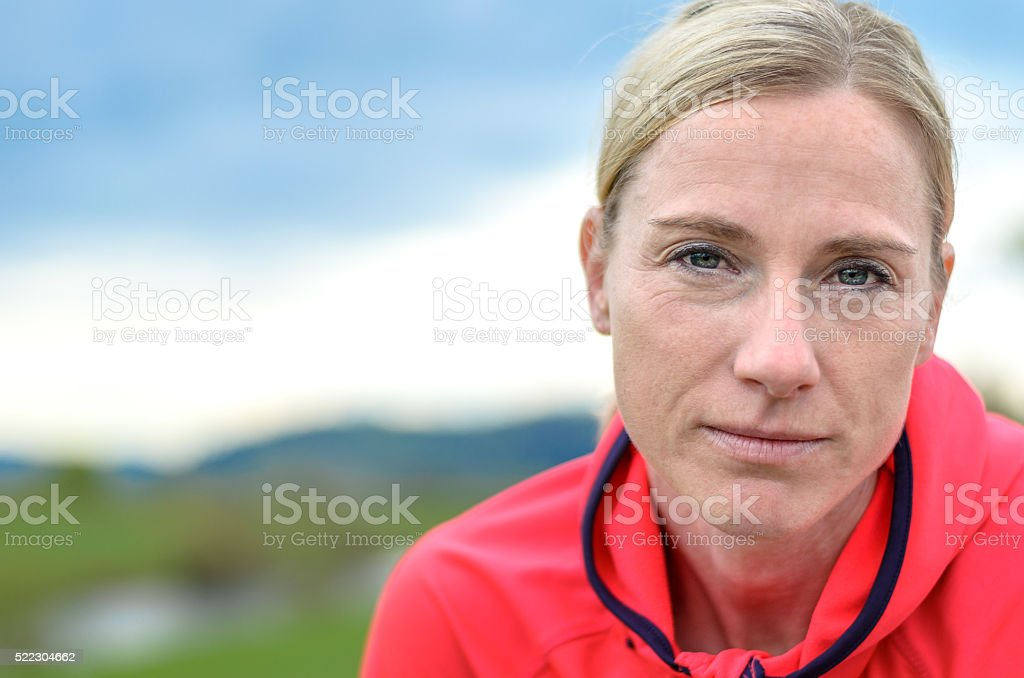 Attractive woman looking intently at the camera stock photo