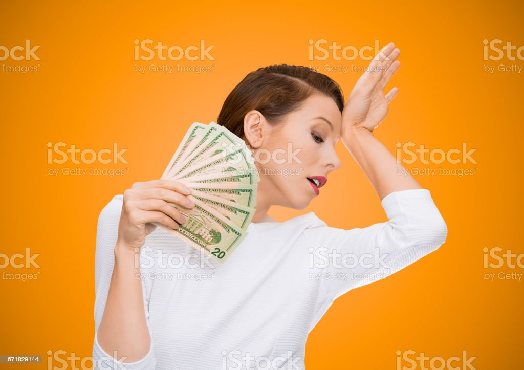attractive woman model holding dollar banknotes lie fan, feels tired melancholic detached from reality, stock photo