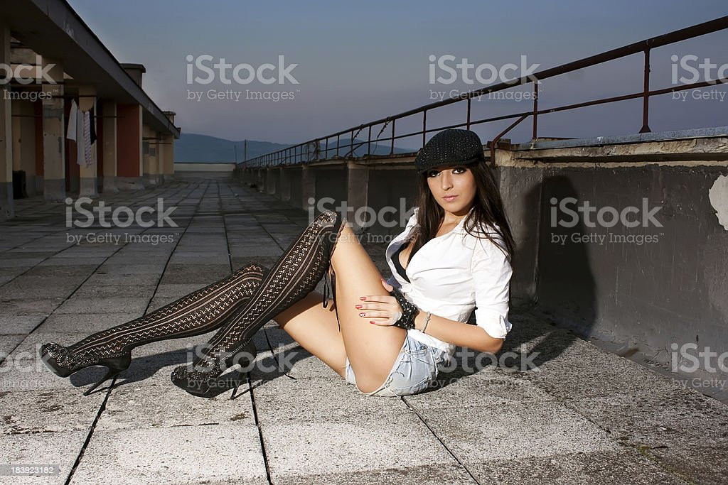 Attractive woman on a rooftop stock photo