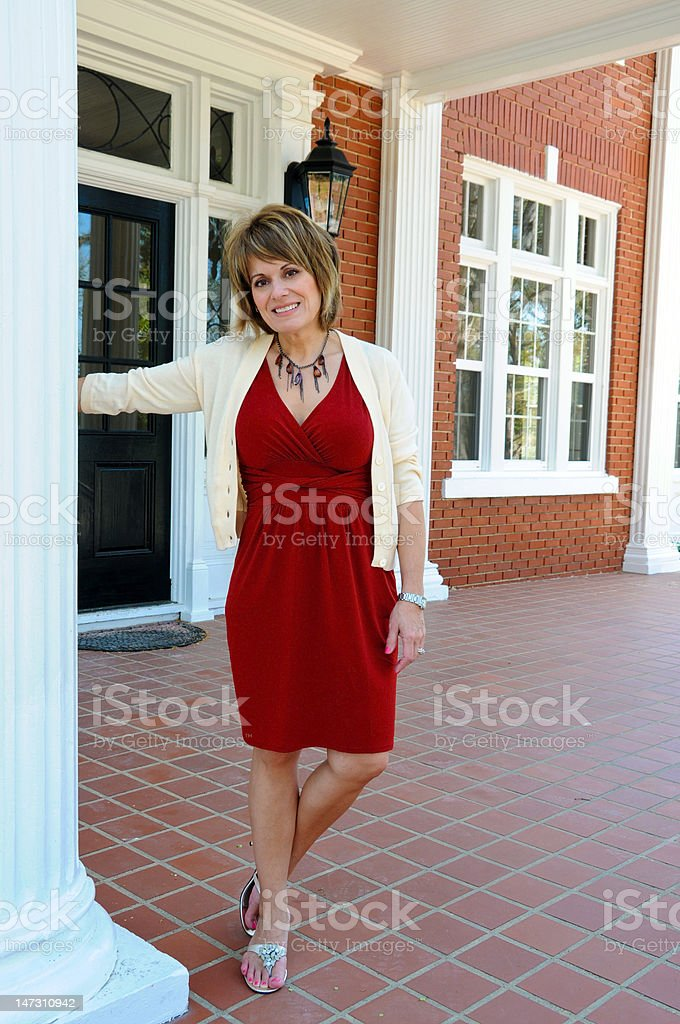 Attractive Woman on Porch royalty-free stock photo