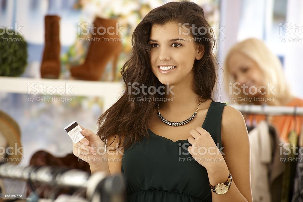 Attractive woman paying by credit card royalty-free stock photo