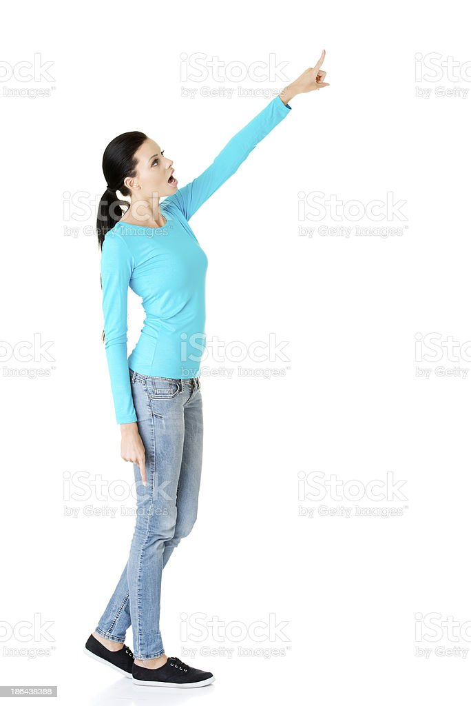 Attractive woman pointing on highcopy space. royalty-free stock photo
