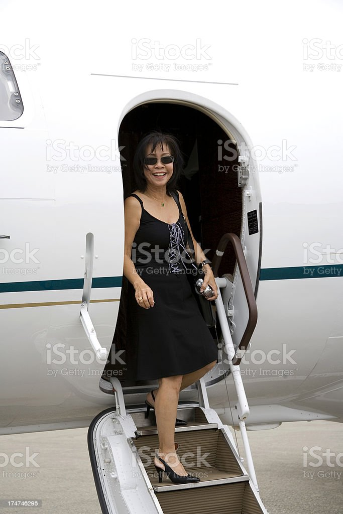 Attractive Woman, Private Jet royalty-free stock photo
