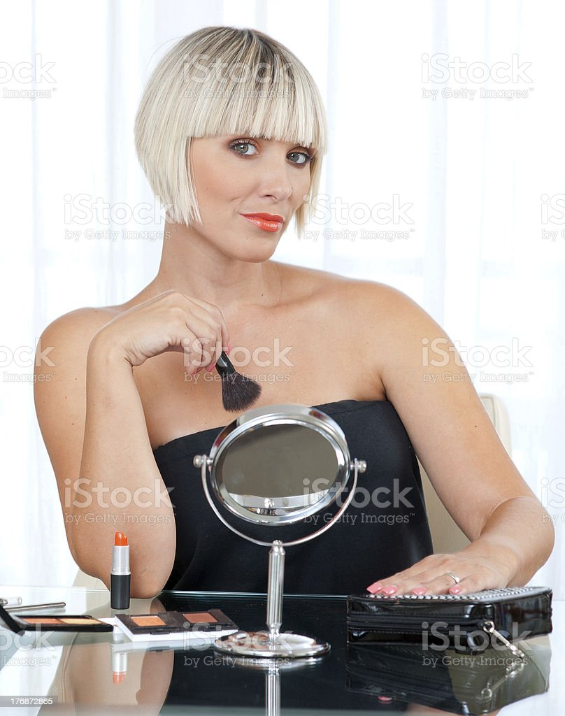 attractive woman putting make up royalty-free stock photo