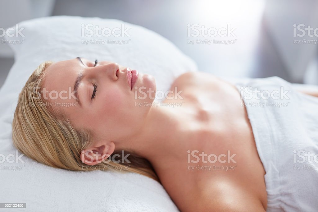 Attractive woman relaxing at dayspa stock photo