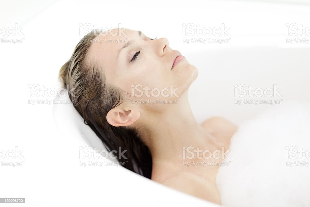 Attractive Woman Relaxing In Bathtub royalty-free stock photo