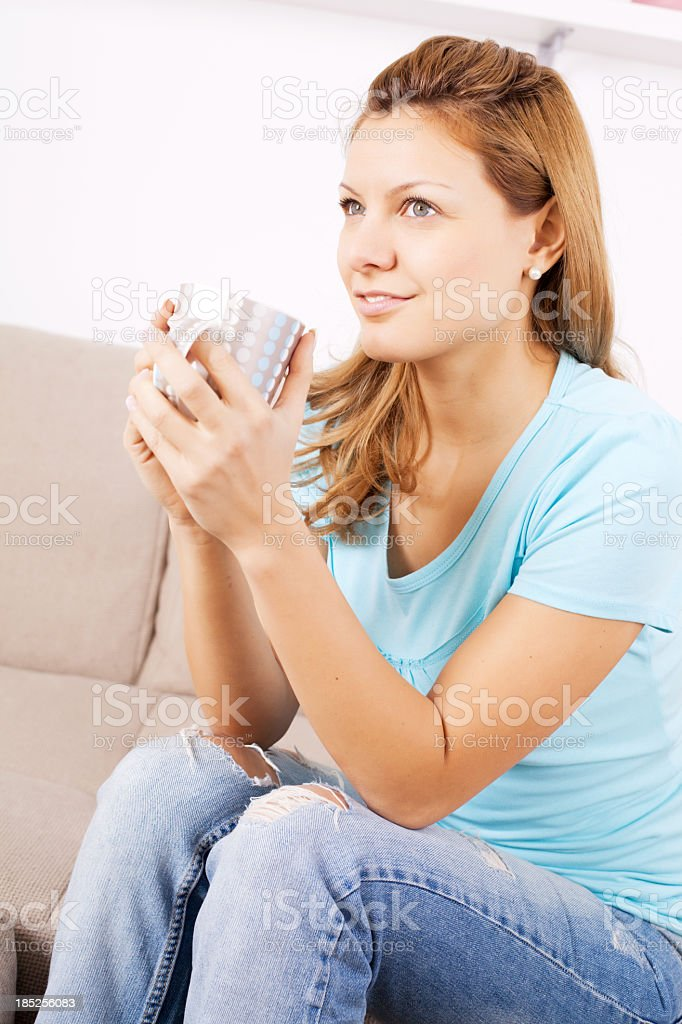 Attractive woman relaxing in living room. royalty-free stock photo