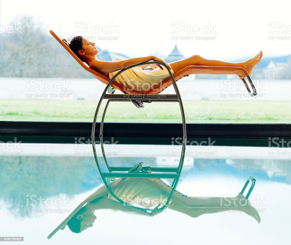 Attractive woman relaxing in spa and resting near pool stock photo