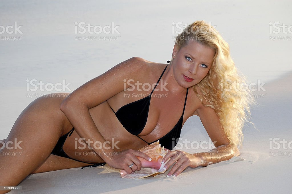 Attractive woman relaxing on the beach royalty-free stock photo