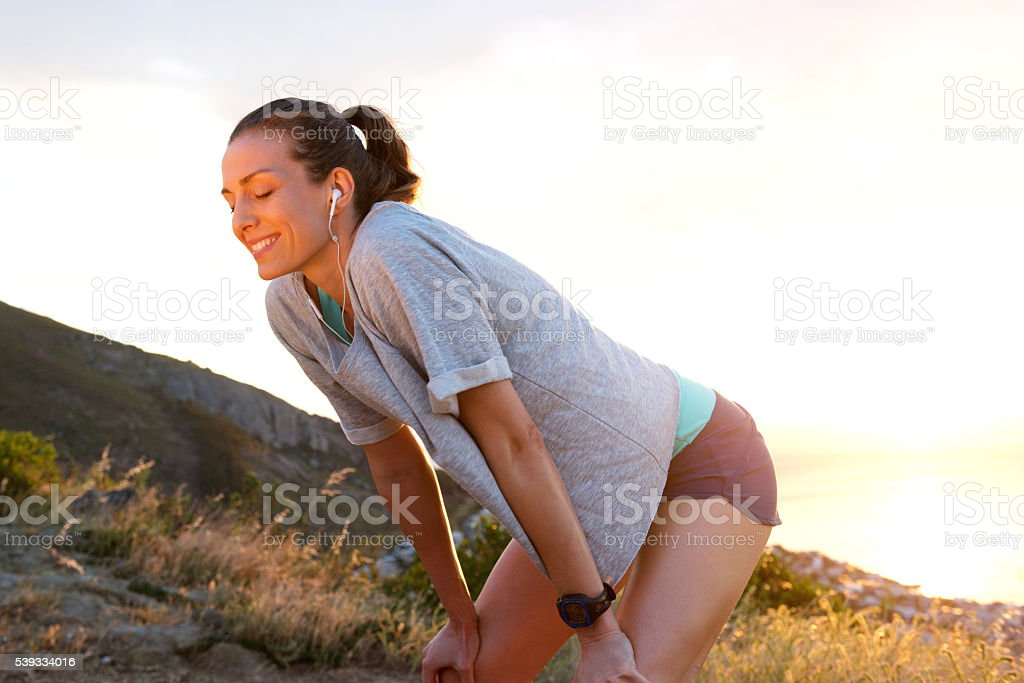 Attractive woman resting after workout stock photo