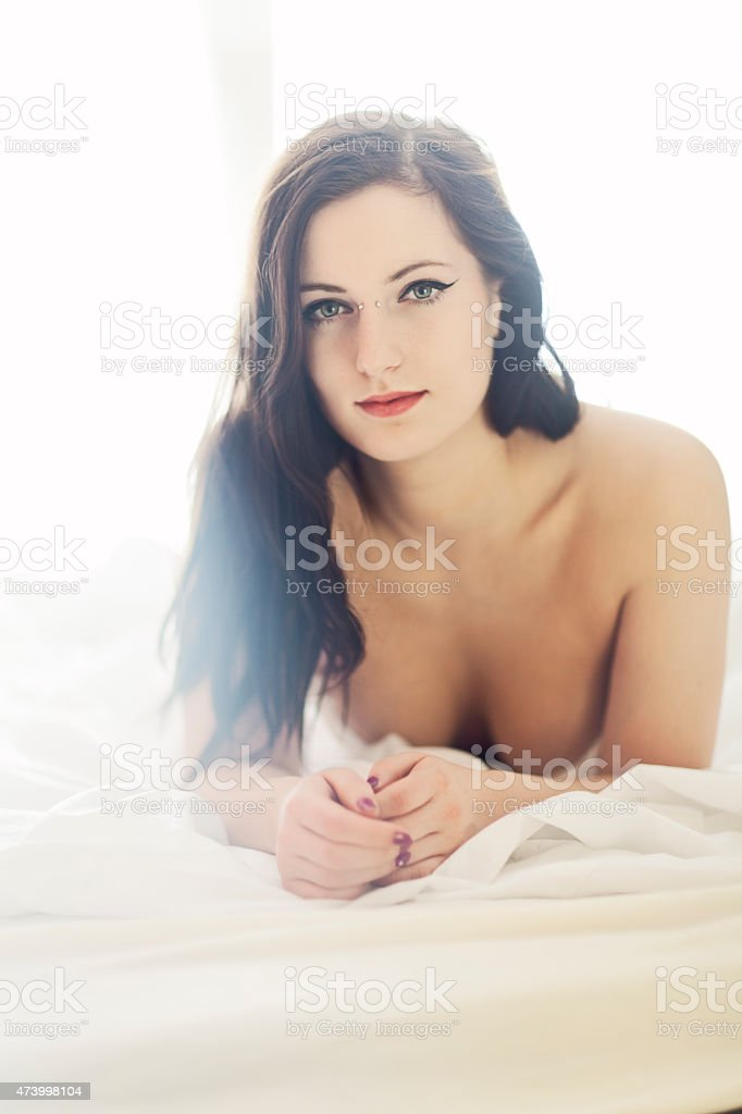Attractive Woman Resting In Bed stock photo
