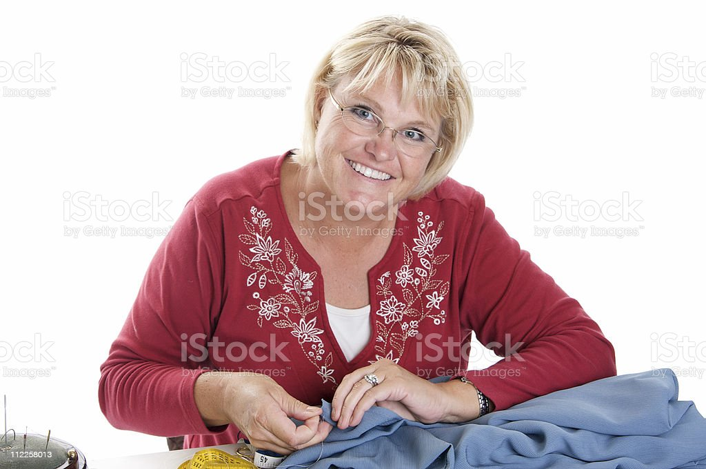 Attractive Woman Sewing by Hand stock photo