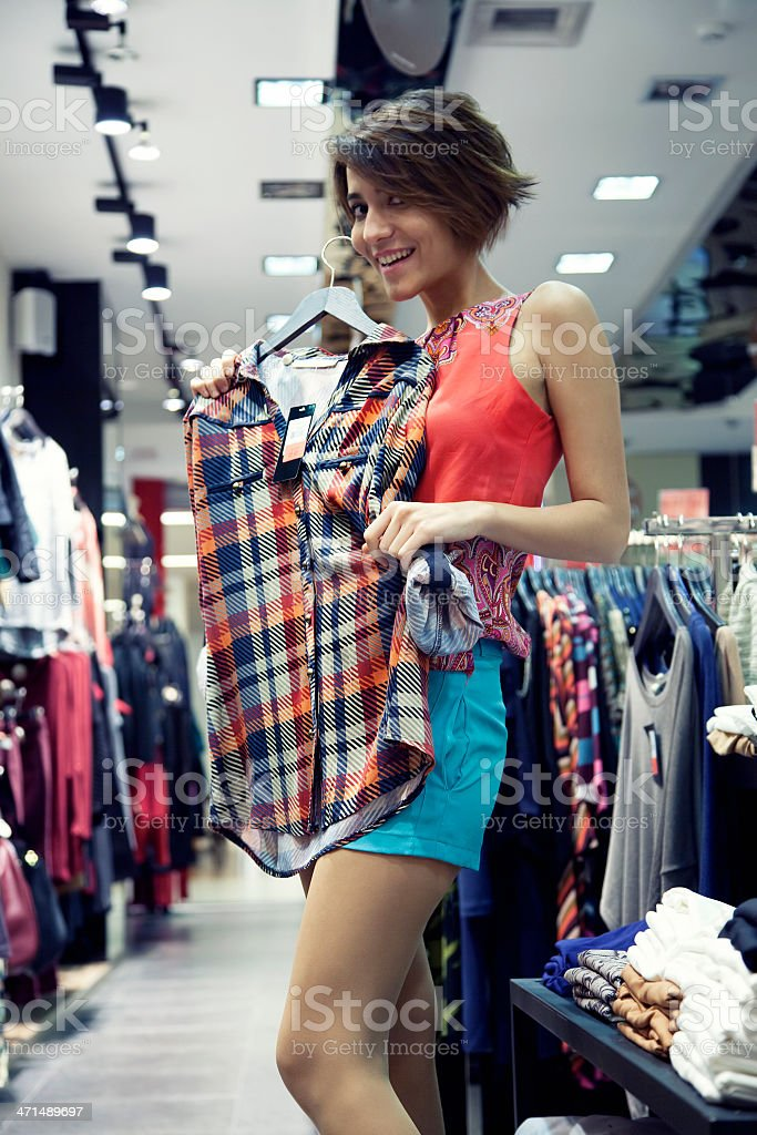 Attractive woman shopping in clothing store royalty-free stock photo