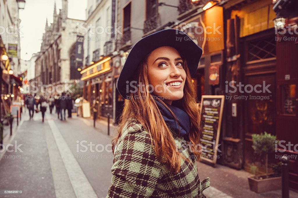 Attractive woman sightseeing in Paris stock photo