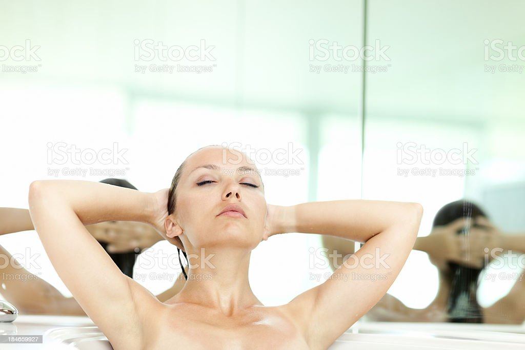 Attractive Woman Sitting In Bathtub royalty-free stock photo