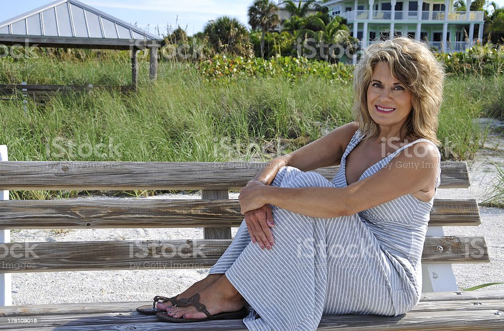 Attractive Woman Sitting on a Bench stock photo