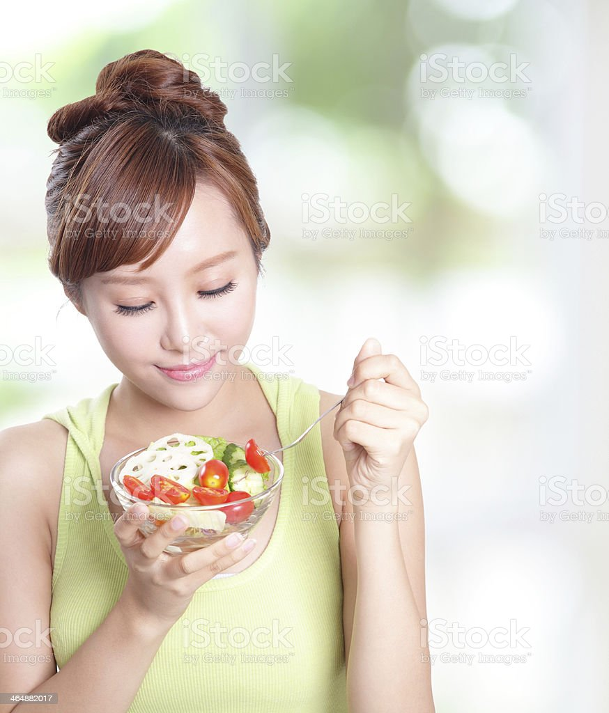 attractive woman smile eating salad royalty-free stock photo