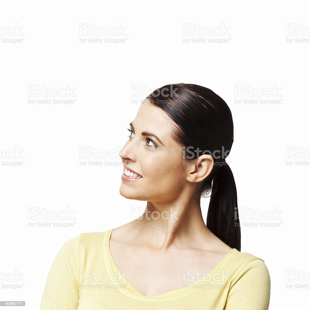 Attractive Woman Smiling And Looking Up - Isolated royalty-free stock photo
