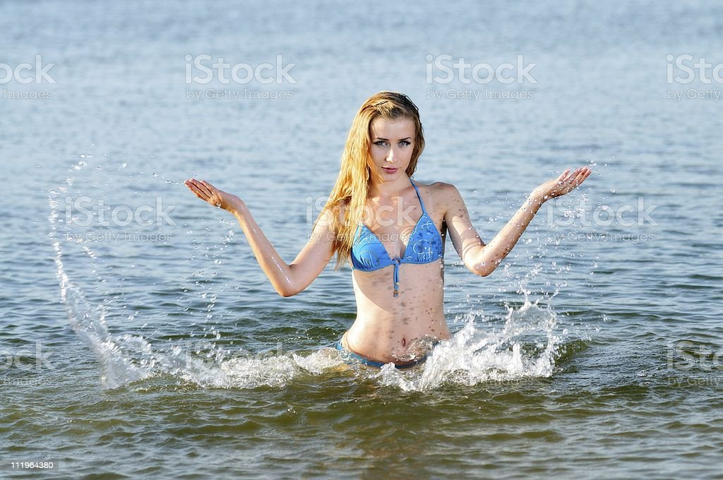 Attractive woman splashing in water stock photo