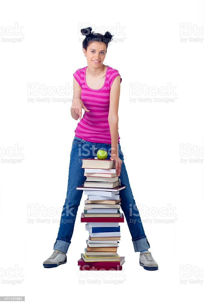 attractive woman standing behind stack of books royalty-free stock photo