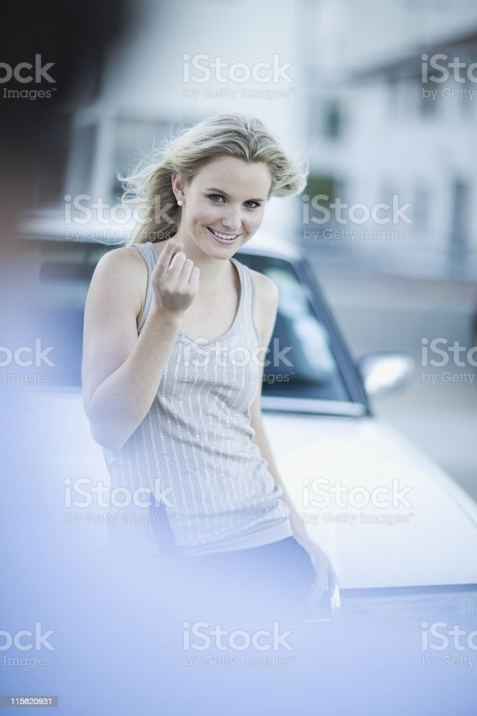 Attractive woman standing infront of car stock photo