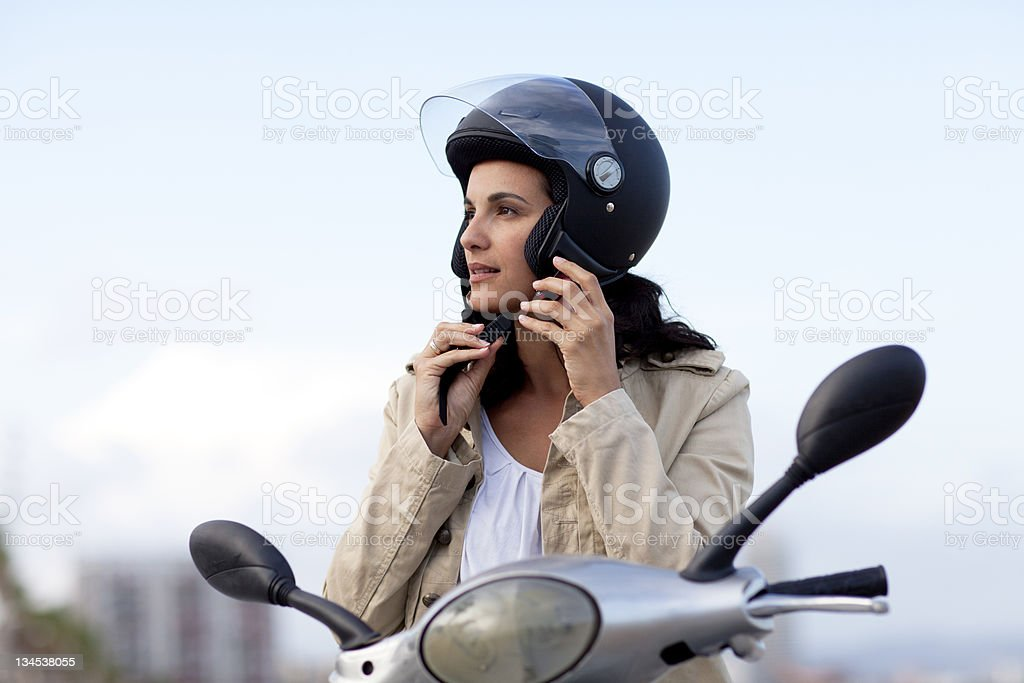 Attractive woman takes off her helmet stock photo