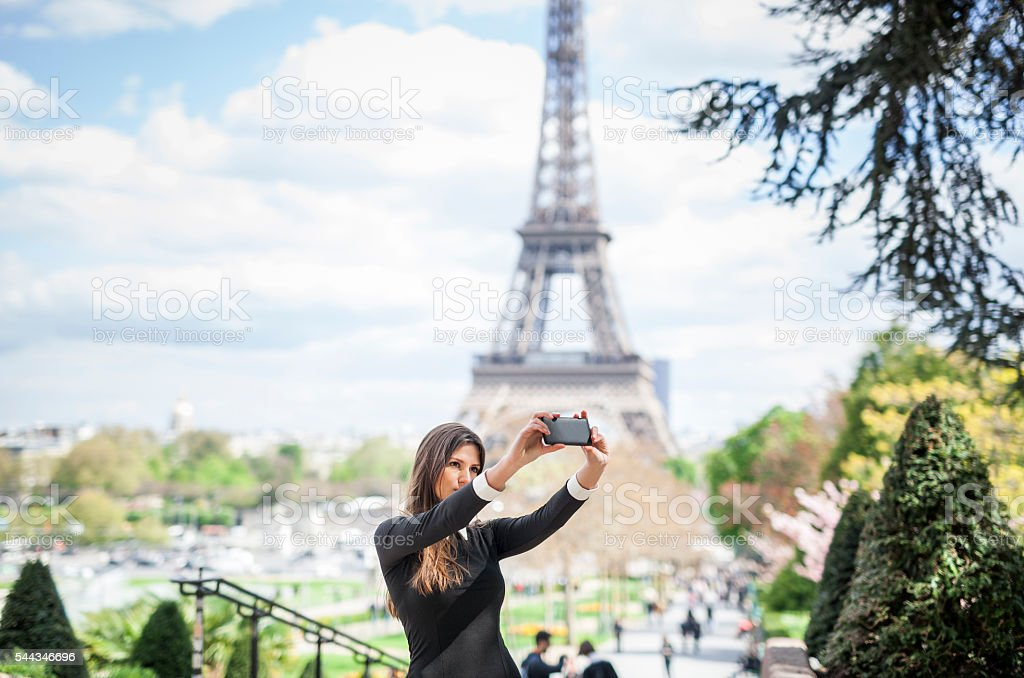 Attractive Woman Taking A Selfie At The Eiffel Tower stock photo