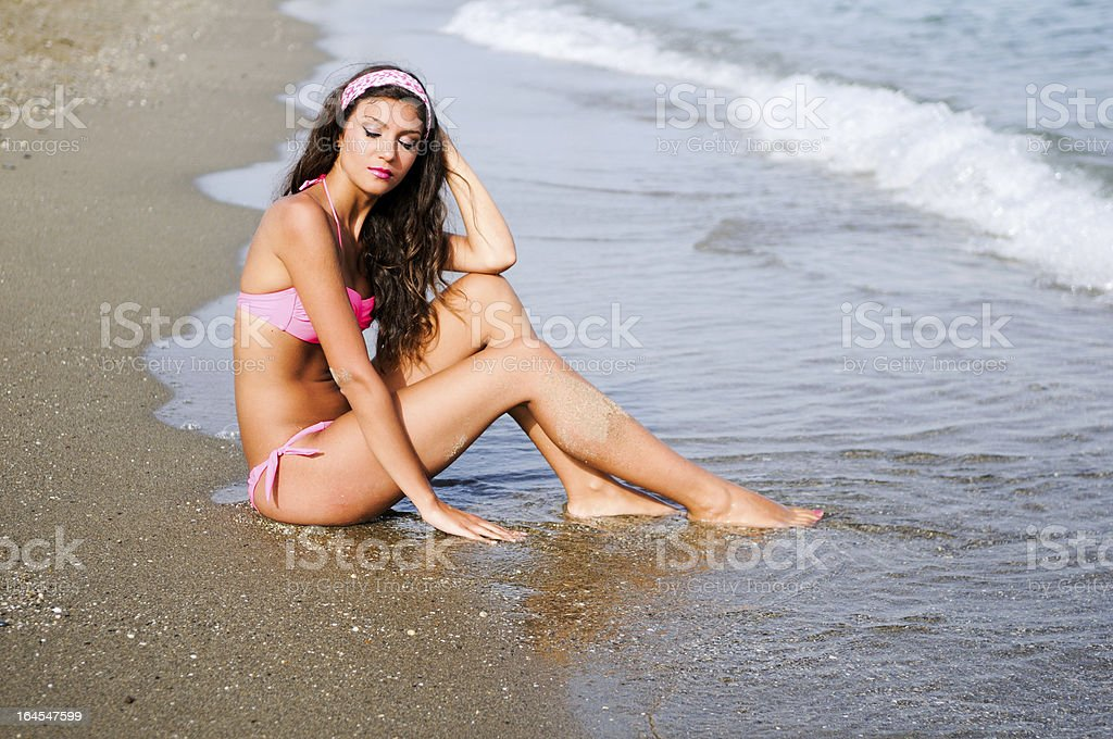 Attractive woman taking sun on a tropical beach royalty-free stock photo