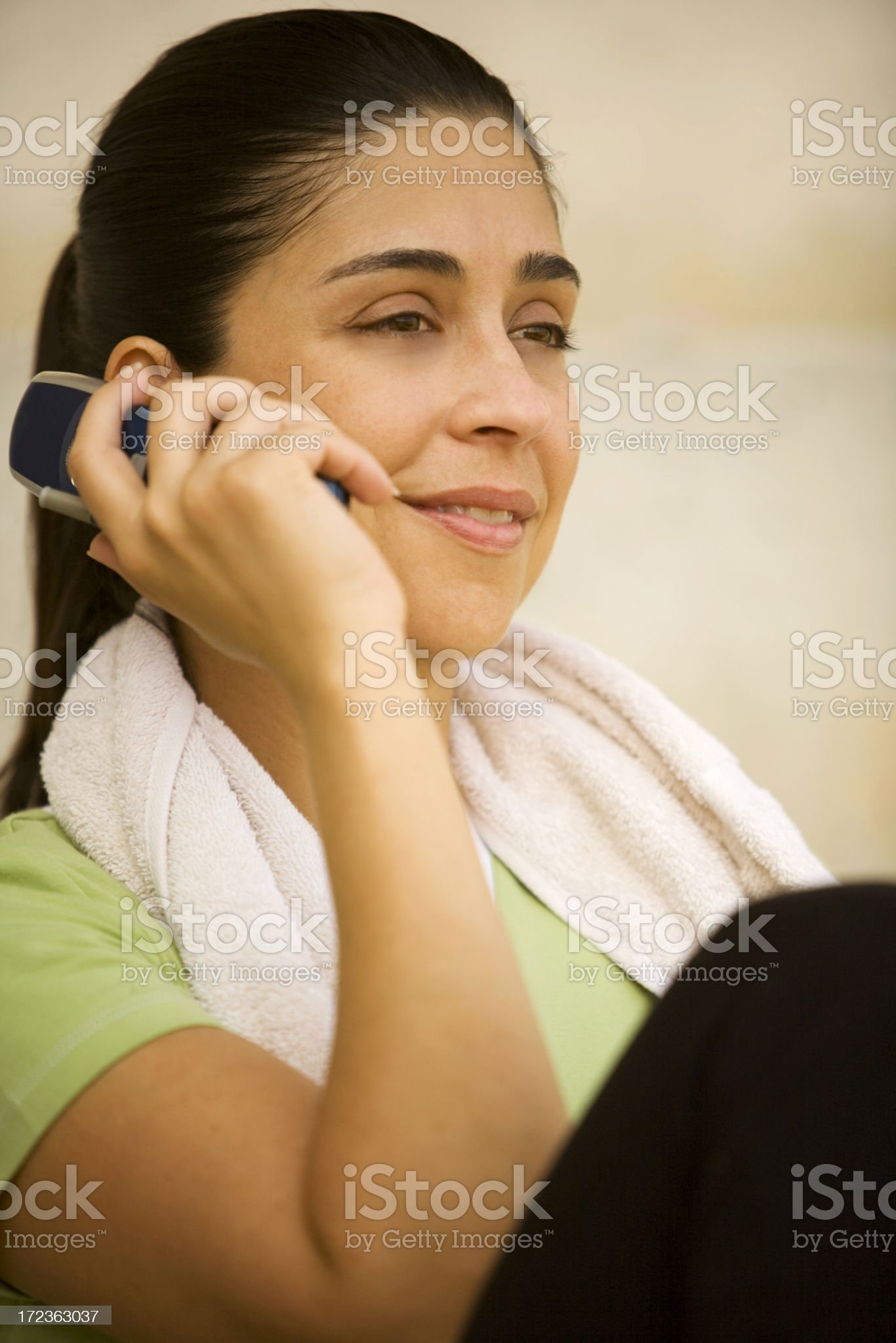 Attractive woman talking on cellphone. royalty-free stock photo