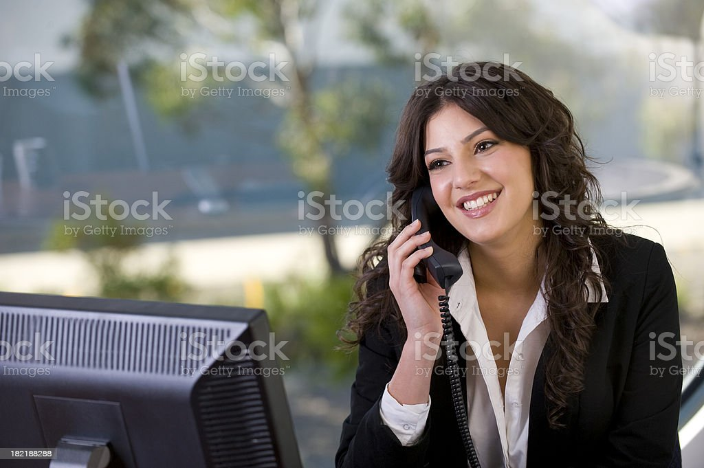 Attractive woman talking on the telephone stock photo