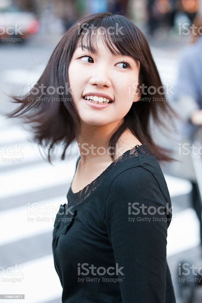 Attractive woman turning back, looking with a bright smile royalty-free stock photo