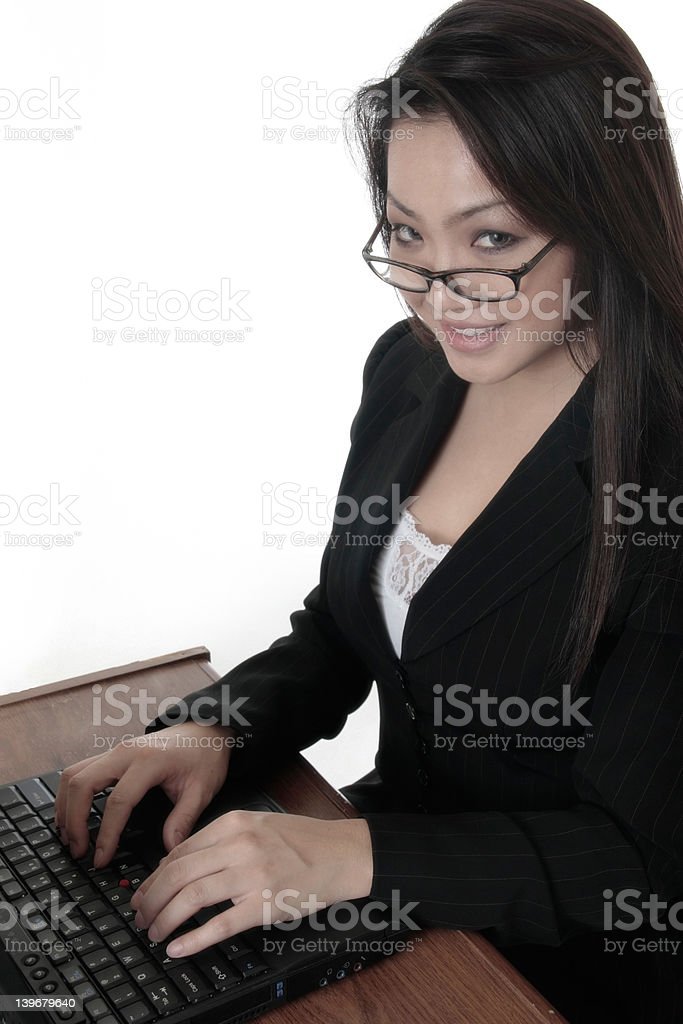 Attractive woman typing on laptop royalty-free stock photo