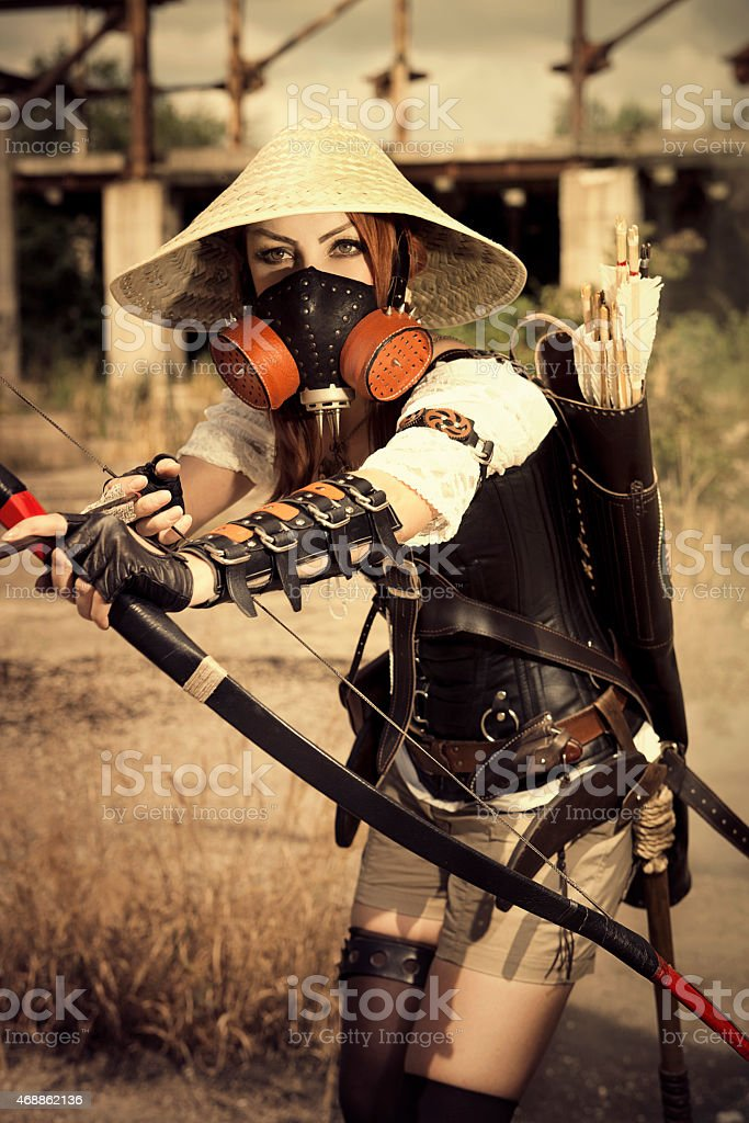 Attractive woman warrior in the mask stock photo