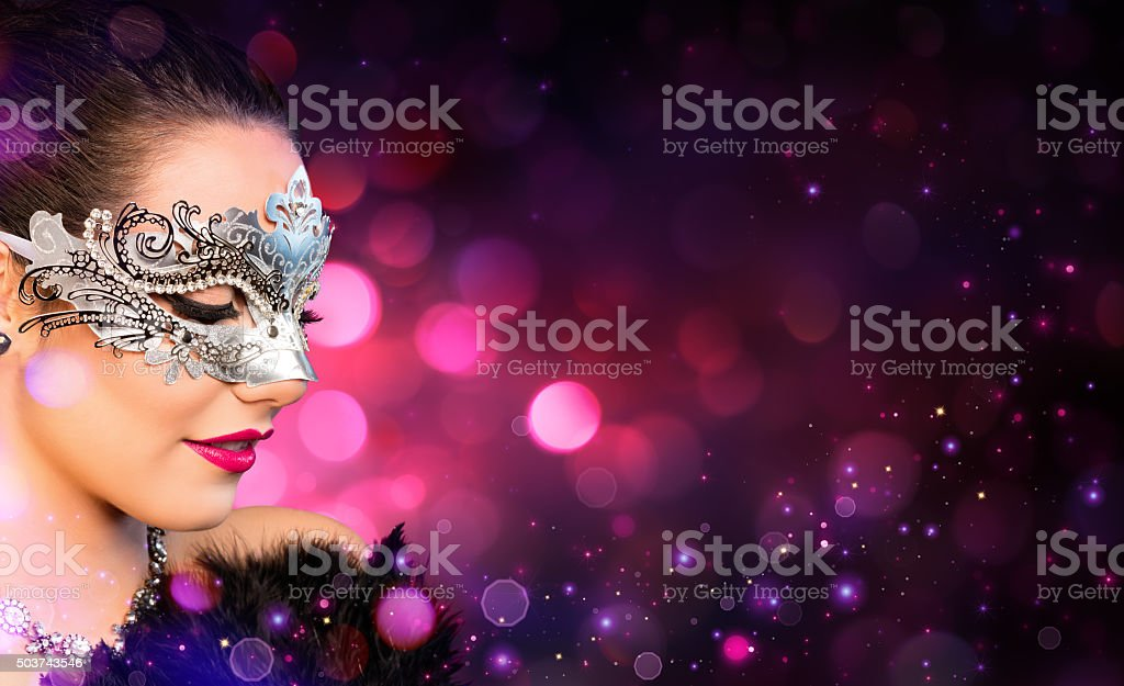 Attractive Woman wearing Carnival Mask stock photo