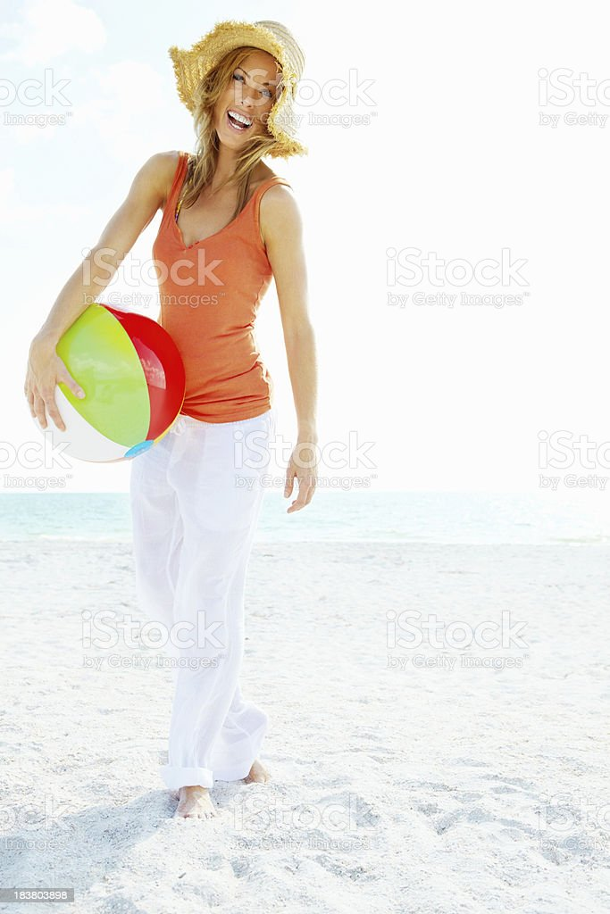 Attractive woman with beach ball royalty-free stock photo