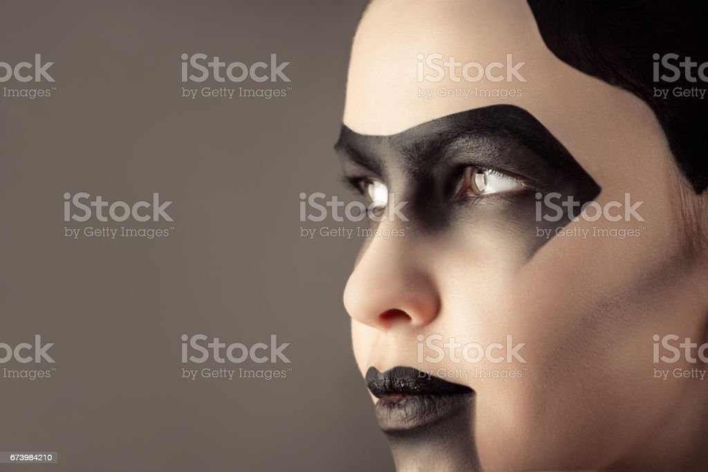 attractive woman with creative dark make-up stock photo