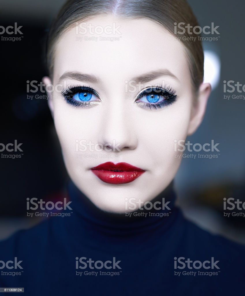 attractive woman with deep blue eyes stock photo