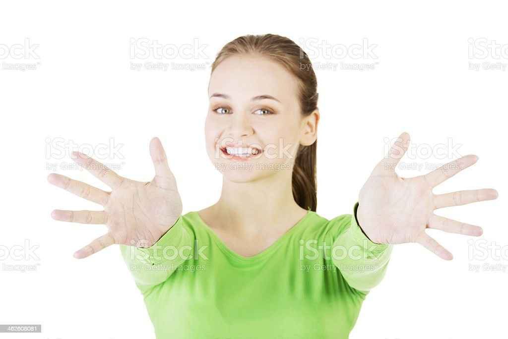Attractive  woman with hands open in front oh her. stock photo