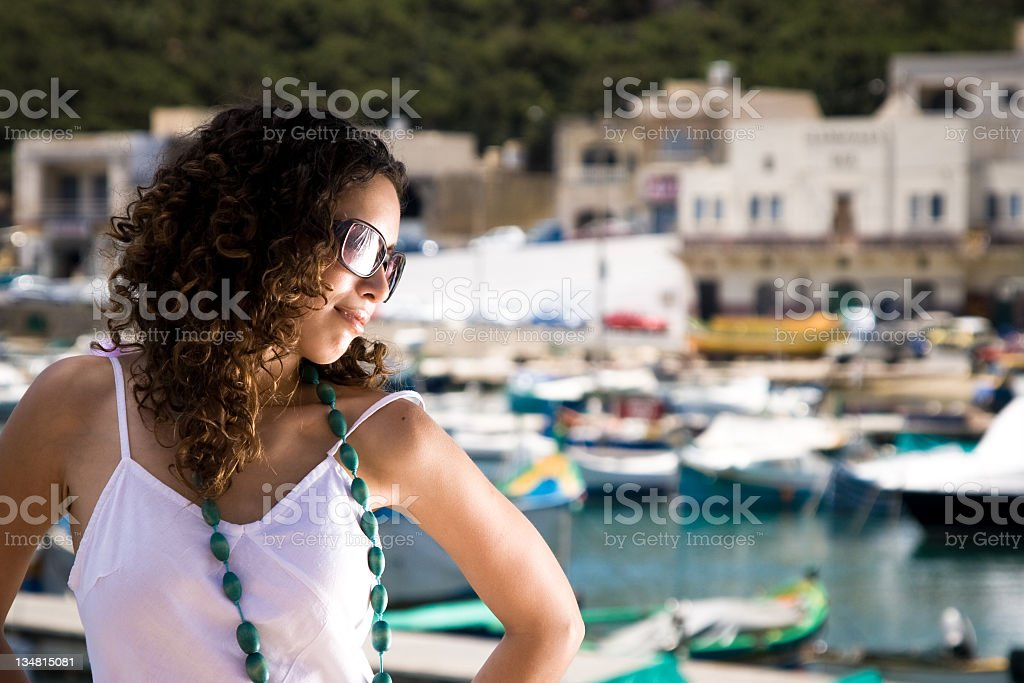 Attractive woman with harbour background royalty-free stock photo