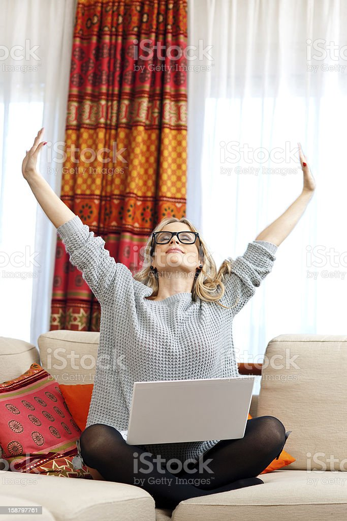attractive woman with laptop in home stock photo
