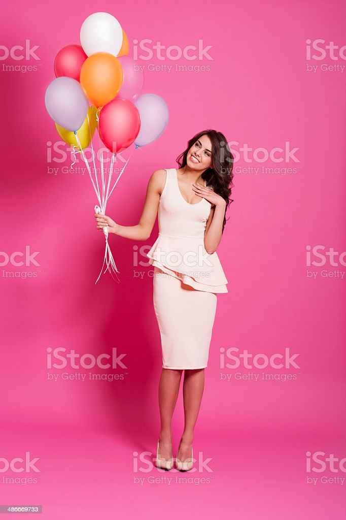 Attractive woman with multi colored balloons stock photo